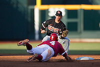 Oregon State shortstop Tyler Smith (1) prepares to tag Indiana outfielder Chris Sujka (4) as he slides into second base during Game 9 of the 2013 Men's College World Series  on June 19, 2013 at TD Ameritrade Park in Omaha, Nebraska. The Beavers defeated the Hoosiers 1-0, eliminating Indiana from the tournament. (Andrew Woolley/Four Seam Images)