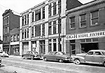 Pittsburgh PA:  View of Forbes Avenue business district between Stevenson and Magee streets in the uptown section of Pittsburgh near Duquesne University - 1950.  Assignment was for a developer trying to get some of the buildings condemned so he could get them at a good price for future development.