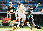 Luka Modric (c) of Real Madrid competes for the ball with Ruben Miguel Nunes Vezo (r) of Granada CF during their La Liga match between Real Madrid and Granada CF at the Santiago Bernabeu Stadium on 07 January 2017 in Madrid, Spain. Photo by Diego Gonzalez Souto / Power Sport Images
