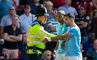 Police hold back Sergio Aguero of Manchester City as a fan is held on the ground during the Premier League match between Bournemouth and Manchester City at the Goldsands Stadium, Bournemouth, England on 26 August 2017. Photo by Andy Rowland.