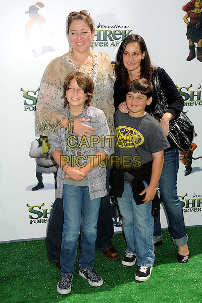 "CAMRYN MANHEIM & GUESTS.""Shrek Forever After"" Los Angeles Premiere held at the Gibson Amphitheatre, Universal City, California, USA..May 16th, 2010.full length beige gold beads top kids children blue grey gray black jeans denim .CAP/ADM/BP.©Byron Purvis/AdMedia/Capital Pictures."