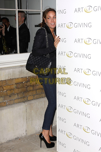 TARA PALMER TOMKINSON .at The Art Of Giving - Private View, Saatchi Gallery, London, England, UK, October 7th 2010..full length skinny jeans black patent platform shoes heels blazer jacket white top bag chanel side .CAP/AH.©Adam Houghton/Capital Pictures.