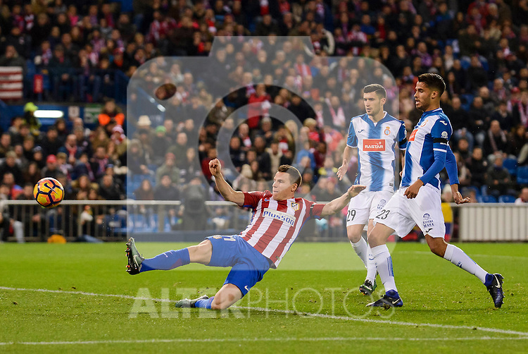 Atletico de Madrid's player Kevin Gameiro and RCD Espanyol player /es29/ and Diego Reyes during match of La Liga between Atletico de Madrid and RCD Espanyol at Vicente Calderon Stadium in Madrid, Spain. December 03, 2016. (ALTERPHOTOS/BorjaB.Hojas)