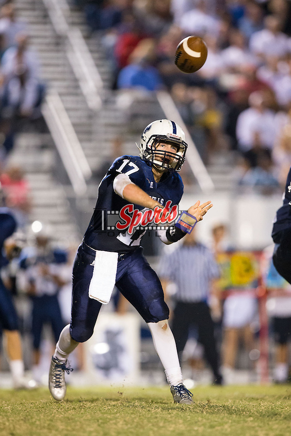 Greg Waslo (17) of the Hickory Ridge Ragin' Bulls passes the football during first half action against the Central Cabarrus Vikings at Hickory Ridge High School on September 26, 2014 in Harrisburg, North Carolina.  The Ragin' Bulls defeated the Vikings 21-17.  (Brian Westerholt/Sports On Film)