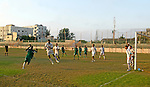 """Palestinian teams """"services rafah"""" and """"Qadisiyah"""" plays a soccer match on the stadium a Young people of Rafah southern Gaza Strip on July 22, 2009. the end of the match between the two of services Rafah and Qadisiyah without Objectives. Photo By Abed Rahim Khatib"""