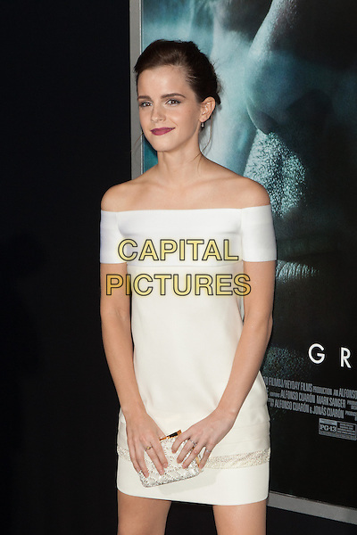 Emma Watson<br /> The 'Gravity' premiere at AMC Lincoln Square Theater, New York City, NY., USA.<br /> October 1st, 2013<br /> half length white dress yellow off the shoulder clutch bag<br /> CAP/MPI/COR<br /> &copy;Corredor99/ MediaPunch/Capital Pictures