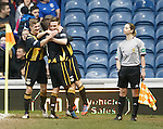 Assistant referee Lorraine Clark watches as Berwick celebrate after Ross Gray's goal