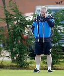 Ally McCoist takes a call on his phone at training today