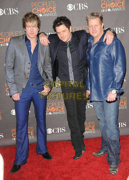 RASCAL FLATTS.Arrivals at the 2010 People's Choice Awards held at the Nokia Theater L.A. Live in Los Angeles, California, USA. .January 6th, 2010.full length black blue grey gray trousers suit leather arm over shoulder .CAP/RKE/DVS.©DVS/RockinExposures/Capital Pictures.
