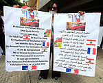 Anti-Hezbollah protesters hold placards during a sit-in against Hezbollah and Iran in front of the French ambassador's house, in Beirut, Lebanon, July 14, 2020. Photo by Haitham Al-Mousawi