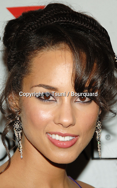 Alicia Keys arriving at the Clive Davis Pre-Grammys Party at the Beverly Hilton In Los Angeles. February 7, 2006.