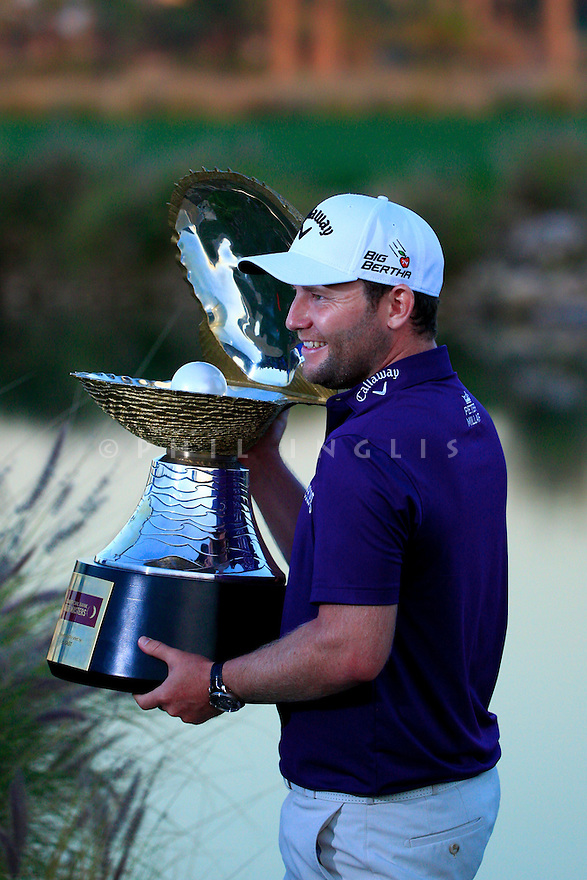 Branden Grace (RSA) poses with the trophy after the final round of the Commercial Bank Qatar Masters played at Doha Golf Club, Doha, Qatar. 21-24 January 2015 (Picture Credit / Phil Inglis)