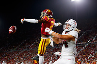 LOS ANGELES, CA - SEPTEMBER 8: USC Trojans safety Dorian Hewett #22 deflects a pass intended for Stanford Cardinal tight end Colby Parkinson #84 during a game between USC and Stanford Football at Los Angeles Memorial Coliseum on September 7, 2019 in Los Angeles, California.