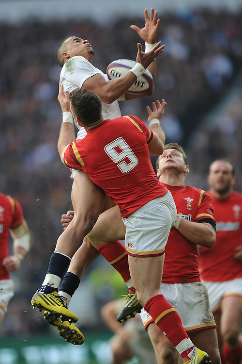 Jonathan Joseph of England outjumps Gareth Davies of Wales to secure the high ball during the RBS 6 Nations match between England and Wales at Twickenham Stadium on Saturday 12th March 2016 (Photo: Rob Munro/Stewart Communications)