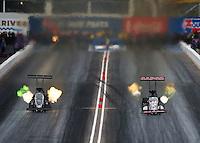 Feb 20, 2015; Chandler, AZ, USA; NHRA top fuel driver Shawn Langdon (left) races alongside Steve Torrence during qualifying for the Carquest Nationals at Wild Horse Pass Motorsports Park. Mandatory Credit: Mark J. Rebilas-