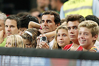 Spanish driver Pedro Martinez De La Rosa with his family during 2014 FIBA Basketball World Cup Quarter-Finals match.September 9,2014.(ALTERPHOTOS/Acero)