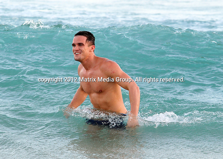 26 JANUARY 2013 SYDNEY AUSTRALIA ..EXCLUSIVE ..Gary (Gaz) Beadle of the MTV hit UK Reality TV show 'Geordie Shore' pictured relaxing with his posse at Bucket List Bondi before taking a dip at Bondi Beach....*No internet without clearance*.MUST CALL PRIOR TO USE ..+61 2 9211-1088.Matrix Media Group.Note: All editorial images subject to the following: For editorial use only. Additional clearance required for commercial, wireless, internet or promotional use.Images may not be altered or modified. Matrix Media Group makes no representations or warranties regarding names, trademarks or logos appearing in the images.