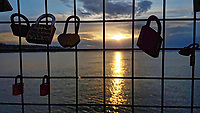 Pictured: Sunset as seen from padlocks left at Newhaven Lighthouse near Edinburgh.<br /> Re: Edinburgh, Scotland, UK. 06 April 2018