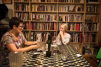 Melanie and Annuska at diningroom table. Family at the progreso apartment, Escandon, Mexico City, Mexico