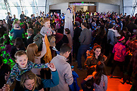 NWA Democrat-Gazette/CHARLIE KAIJO Visitors party during the Noon Year's Eve event on Sunday, December 31, 2017 at Crystal Bridges in Bentonville. Visitors rang in the New Year (without staying up past bedtime) at the third annual family celebration including arts projects, performances and a family dance party.