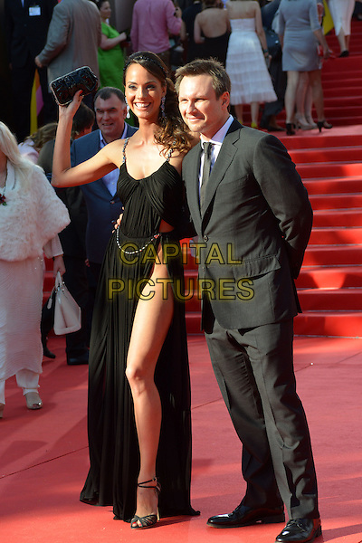 Sofya Skya, Christian Slater<br /> The opening of the Moscow International Film Festival, Moscow, Russia.<br /> June 20th, 2013<br /> full length black suit shirt white tie dress slit split thigh leg hand arm waving <br /> CAP/PER/LS<br /> &copy;LS/PersonaStars/CapitalPictures