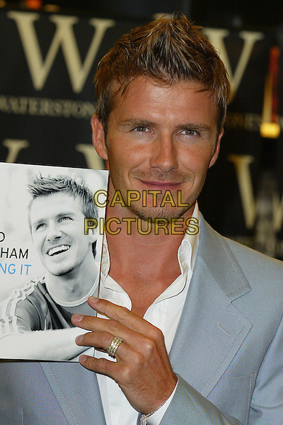 "DAVID BECKHAM.at Waterstones bookshop, Oxford Street to sign copies of his new book.""David Beckham; Making it Real"".London England 18th September 2006.Ref: DAR.headshot portrait stubble ring.www.capitalpictures.com.sales@capitalpictures.com.©Darwin/Capital Pictures"