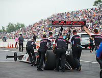 Aug 19, 2018; Brainerd, MN, USA; Crew members for NHRA top fuel driver Billy Torrence during the Lucas Oil Nationals at Brainerd International Raceway. Mandatory Credit: Mark J. Rebilas-USA TODAY Sports
