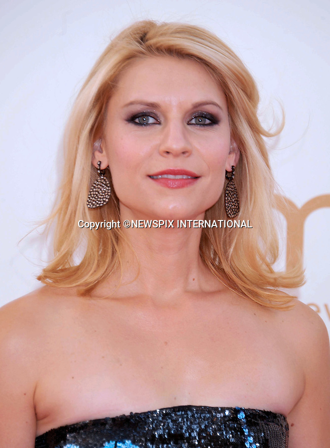 "CLAIRE DANES.attends the Academy of Television Arts & Sciences 63rd Primetime Emmy Awards at Nokia Theatre L.A. Live, Los Angeles_18/09/2011.Mandatory Photo Credit: ©Crosby/Newspix International. .**ALL FEES PAYABLE TO: ""NEWSPIX INTERNATIONAL""**..PHOTO CREDIT MANDATORY!!: NEWSPIX INTERNATIONAL(Failure to credit will incur a surcharge of 100% of reproduction fees).IMMEDIATE CONFIRMATION OF USAGE REQUIRED:.Newspix International, 31 Chinnery Hill, Bishop's Stortford, ENGLAND CM23 3PS.Tel:+441279 324672  ; Fax: +441279656877.Mobile:  0777568 1153.e-mail: info@newspixinternational.co.uk"