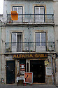Lisbon, Portugal. 21.03.2015. Alfama Grill, which offers Fado to accompany one's meal, in typical narrow street in the Alfama district of Lisbon. © Jane Hobson.