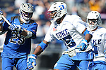 08 February 2015: Duke's Myles Jones (15) runs past Air Force's Luke Leathers (23). The Duke University Blue Devils hosted the United States Air Force Academy Falcons at Koskinen Stadium in Durham, North Carolina in a 2015 NCAA Division I Men's Lacrosse match. Duke won the game 13-7.