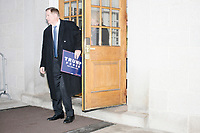 A Trump supporter leaves the NH State House before Vice President Mike Pence leaves the New Hampshire Secretary of State's office in the New Hampshire State House in Concord, New Hampshire, on Thu., November 7, 2019. Pence traveled to New Hampshire as a surrogate for Donald Trump to file required paperwork for the president to get on the New Hampshire presidential primary ballot in 2020. The required documents include a filing form signed by the candidate and a $1000 filing fee.