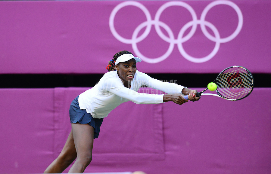 Aug 4, 2012; London, United Kingdom; Venus Williams (USA) against Russia during the women's doubles semi finals at the London 2012 Olympic Games at Wimbledon. Mandatory Credit: Mark J. Rebilas-USA TODAY Sports