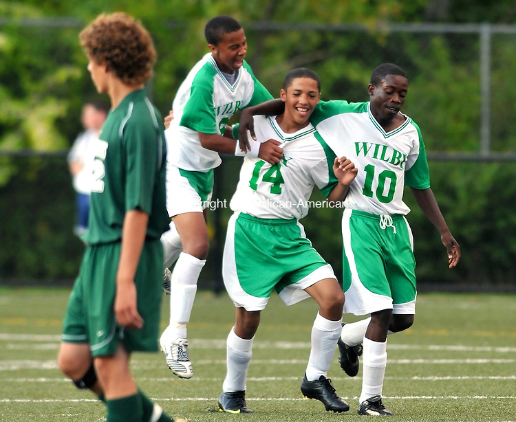WATERBURY, CT-05 SEPTEMBER 2009-090509JS10-Wilby's Manny Cruz (14) is congratulated by teammates Jayde Ramos (6), left, and Regal Dakin (10) right, after scoring a goal during their game against Chase Collegiate Saturday in the first Waterbury soccer Jamboree at Municipal Staduim in Waterbury. <br /> Jim Shannon Republican-American