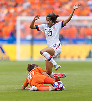 LYON,  - JULY 7: Dominique Bloodworth #20 tackles Christen Press #23 during a game between Netherlands and USWNT at Stade de Lyon on July 7, 2019 in Lyon, France.