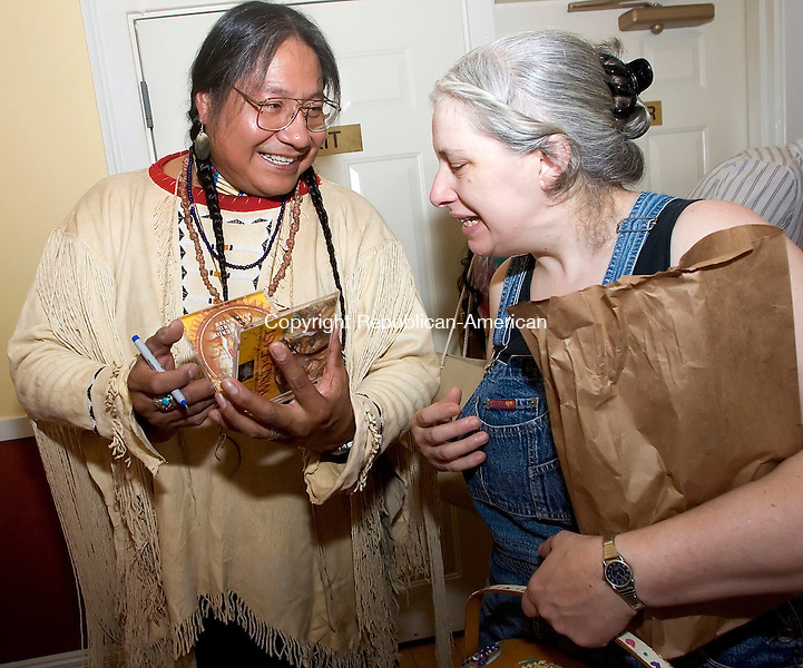 TORRINGTON, CT- 17 JULY 2008- 071708JT04-<br /> Cheyenne Native American flutist Chief Joseph Firecrow sigs a CD for Deirdre Denny of Torrington after he performed at the Prime Time House on Thursday. The event was part of a multicultural diversity program at the house. Firecrow, who also features drums in his performances, was a Grammy nominee in 2001.<br /> Josalee Thrift / Republican-American