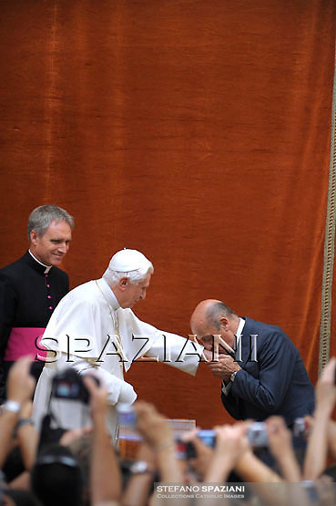 Pope Benedict XVI shakes hands with President of the International Swimming Federation (FINA) Julio Maglione of Uruguay during the audience for competitors the competitors at his summer residence in Castelgandolfo south of Rome on August 1, 2009
