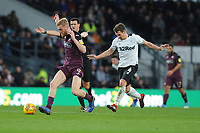 Oli McBurnie of Swansea City vies for possession with Craig Bryson of Derby County during the Sky Bet Championship match between Derby City and Swansea City at the Pride Park Stadium in Derby, England, UK. Saturday 01 December 2018