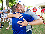MUSCLE SHOALS, AL - MAY 25: Lynn Coach Andrew Danna is congratulated after winning the team championship during the Division II Men's Team Match Play Golf Championship held at the Robert Trent Jones Golf Trail at the Shoals, Fighting Joe Course on May 25, 2018 in Muscle Shoals, Alabama. Lynn defeated West Florida 3-2 to win the national title. (Photo by Cliff Williams/NCAA Photos via Getty Images)
