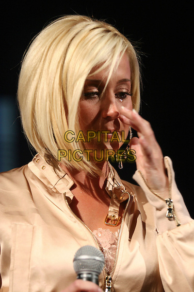 KELLIE PICKLER.The Academy of Country Music presents its fourth annual New Artists Show   featuring performances by Top New Artist' nominees held at the MGM Grand Ballroom in the MGM Grand Convention Center, Las Vegas, Nevada, USA,.14 May 2007 ..live in concert on stage gig portrait headshot crying tears hand wiping touching face.CAP/ADM/BP.©Byron Purvis/AdMedia/Capital Pictures.