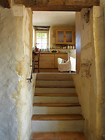 A glimpse of the kitchen from the bottom of a set of tiled steps
