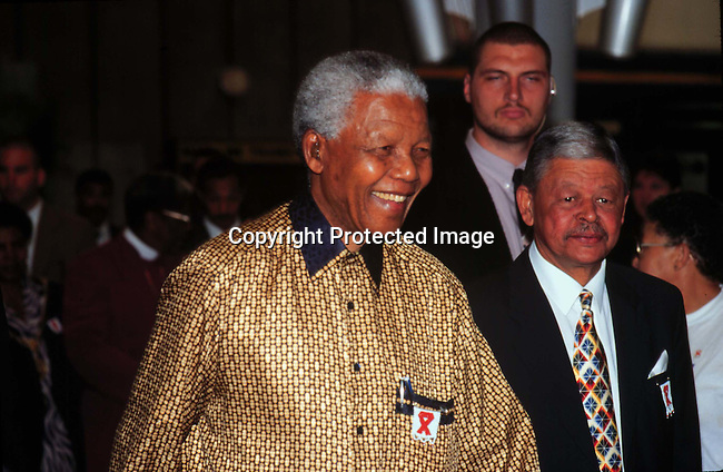 PEMANNE55199.Personality. Nelson Mandela. Attending an Aids awareness function; standing next Gerald Morkel; Aids ribbon..©Per-Anders Pettersson/iAfrika Photos
