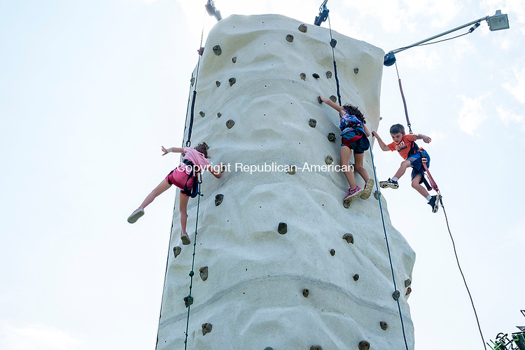 Bridgewater, CT- 19 August 2017-081917CM02- From left,  Gabriella See, 4, Brooke Saraceno 6, and<br /> Daniel See 6 all of New Milford traverse a climbing wall during the annual Bridgewater Fair on Saturday.  The fair concludes on Sunday, with gates opening at 8:00 a.m.  and closing at 6:00 p.m.      Christopher Massa Republican-American