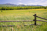Wooden Farm Fence and Meadow with View of White Mountains in New Hampshire