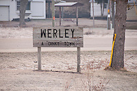 The sign for the small town of Werley near a trout stream in the Driftless Area of Southwestern Wisconsin.