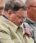 Veteran Robert Thomas of Swansea bows his head during an opening prayer before the ceremony. He served as a Staff Sgt. in the Army and is a member of VFW Post #1739 in Belleville. The city of Belleville held their 21st annual Veterans Day ceremony inside Belleville City Hall on Thursday November 11, 2019. It was moved inside due to the winter weather.<br /> Photo by Tim Vizer