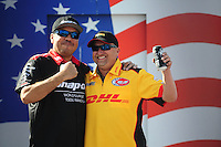 Sept. 6, 2010; Clermont, IN, USA; NHRA funny car driver Cruz Pedregon (left) and Jeff Arend during driver introductions prior to the U.S. Nationals at O'Reilly Raceway Park at Indianapolis. Mandatory Credit: Mark J. Rebilas-
