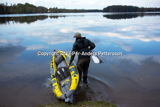 BORAS, SWEDEN - MAY 14: A carries his canoe while going fishing on May 14, 2017 in Dannike outside Boras, Sweden. The lake is called Ramsjon, about twenty minutes outside Boras. (Photo by Per-Anders Pettersson/Getty Images)