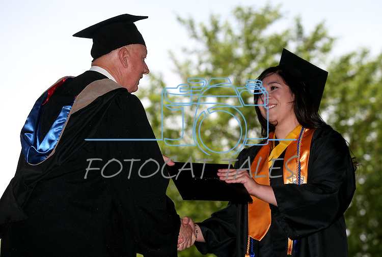 Interim President Chester Burton congratulates Yesenia Pacheco during the Western Nevada College commencement at the Pony Express Pavilion, in Carson City, Nev., on Monday, May 19, 2014. <br /> Photo by Cathleen Allison/Nevada Photo Source