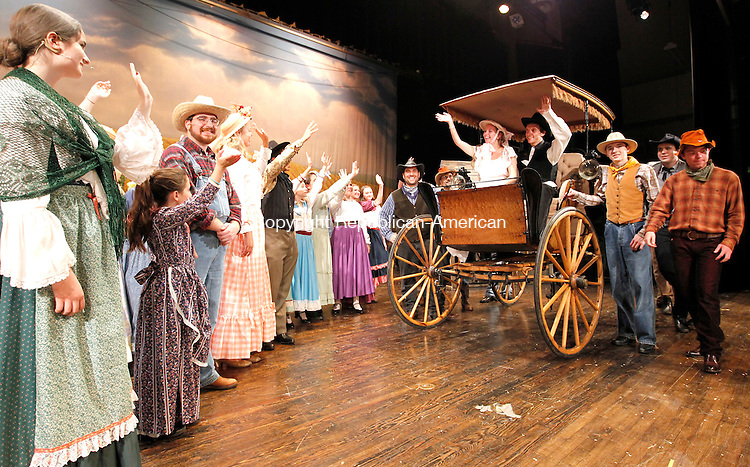 "Southbury, CT-26 July 2012-072612CM09-  Actors, including Gary Dwyer of Middlebury,  as ""Curly"" (in buggy on the right) and Sam McCloghry of Southbury as ""Lori Williams"" (sitting next to him),  from the Newbury Musical Theatre Company' rehearse a production of ""Oklahoma"" Thursday night at Pomperaug High School in Southbury.  The show will run 7pm on Saturday, and 2pm on Sunday at Pomperaug High School on Judd Road in Southbury.  Tickets are $18 for adults, $12 for seniors and $10 for children 10 and under. Tickets will be available at the door.  Christopher Massa Republican-American"