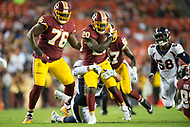 Landover, MD - August 24, 2018: Washington Redskins running back Rob Kelley (20) is tackled by Denver Broncos defensive end Derek Wolfe (95)during preseason game between the Denver Broncos and Washington Redskins at FedEx Field in Landover, MD. The Broncos defeat the Redskins 29-17. (Photo by Phillip Peters/Media Images International)